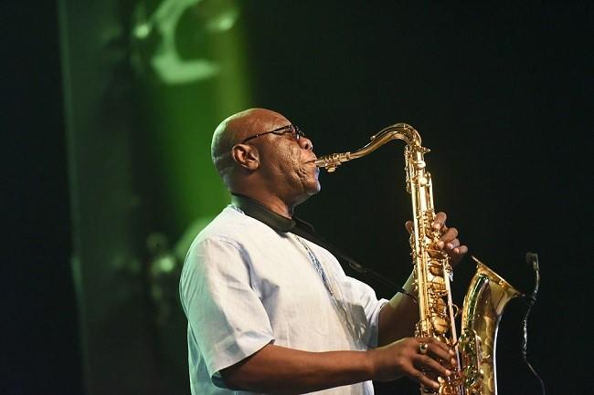 In this file photo taken on June 30, 2018, Emmanuel N'Djoke Dibango, known as Manu Dibango, saxophonist and Franco-Cameroonian singer of world jazz, performs during his concert at the Ivory Hotel Abidjan. – (Photo: Sia KAMBOU / AFP)