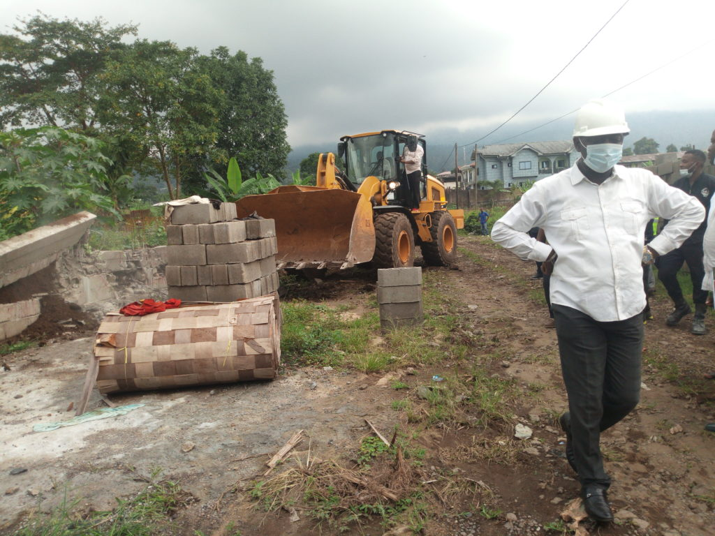 Mayor David Mafani Namange with a face mask during a demolition exercise of illigal building sites in the municipality