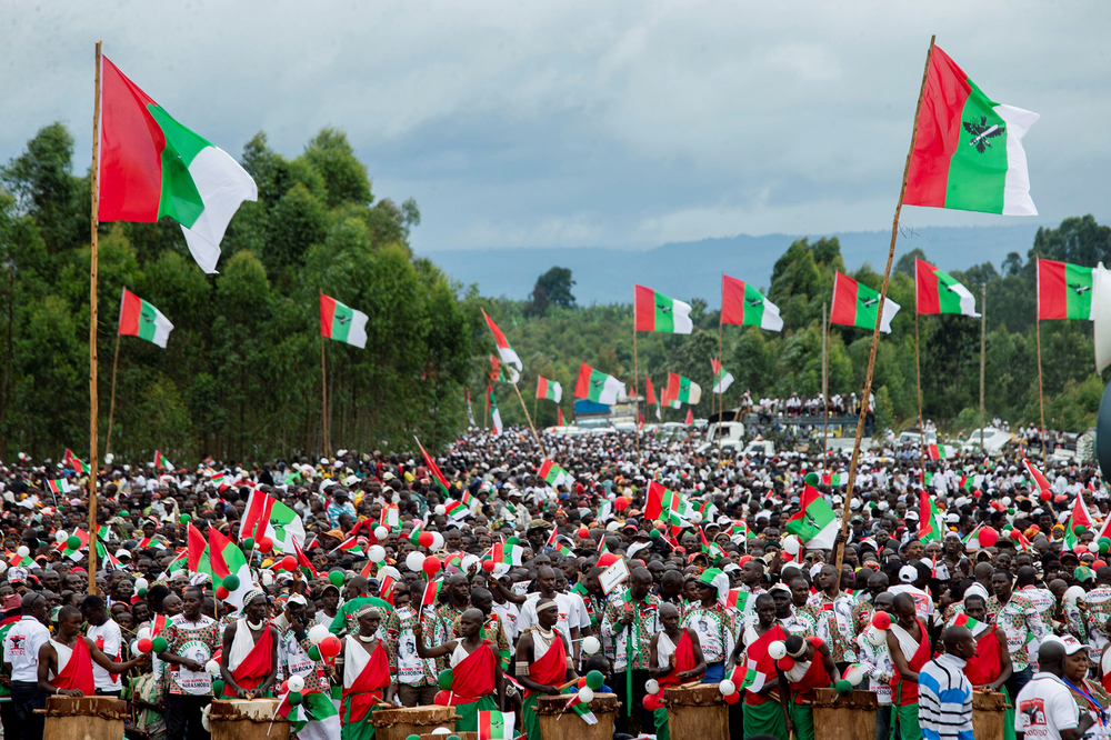 Supporters of Burundi's ruling CNDD-FDD party attend a campaign rally in Gitega province on 27 April (Reuters)