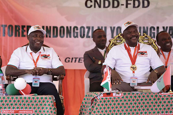 General Evariste Ndayishimiye (L) sits next to incumbent president of Burundi, Pierre Nkurunziza on January 26, 2020 at Gitega, central Burundi, during the ruling party CNDD-FDD's congress to nominate it's presidential candidate for the upcoming presidential elections in 2020. PHOTO | STRINGER | AFP
