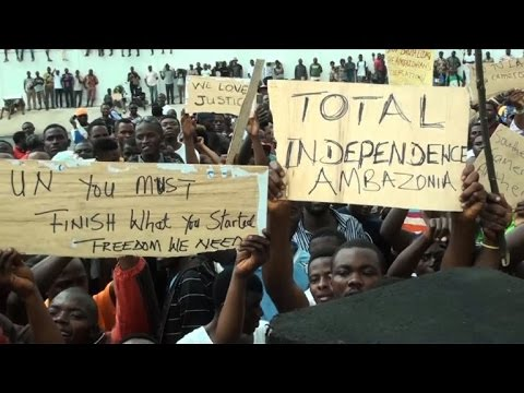 Protesters with messages calling for independence