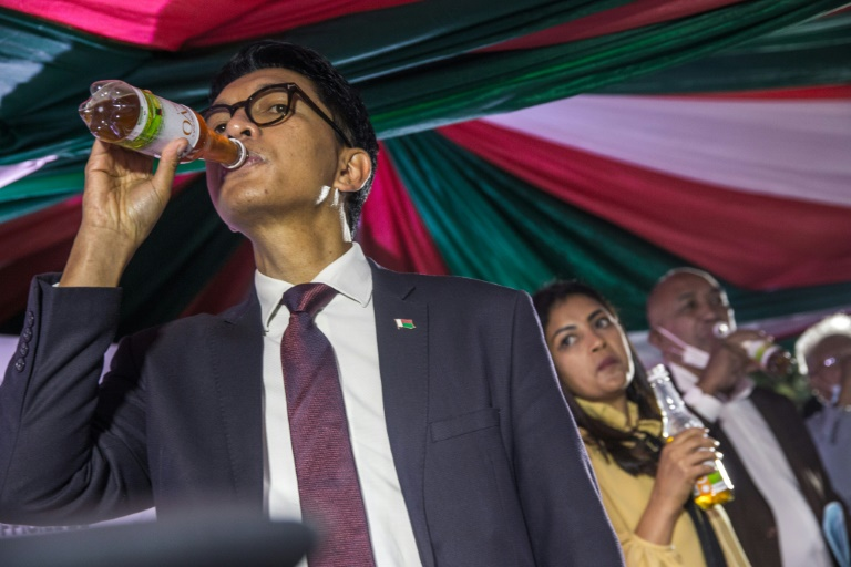 President Andry Rajoelina of Madagascar drinking a sample of Covid Organics which is making waves as a cure for coronavirus