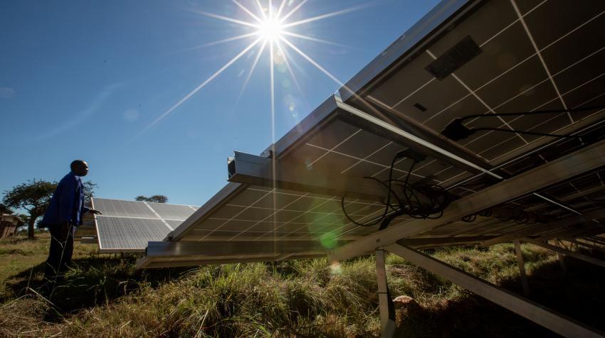 A hospital electrician ensures maintenance of the solar panels at the Nkayi District Hospital, Bulawayo, Zimbabwe. UNDP/Slingshot