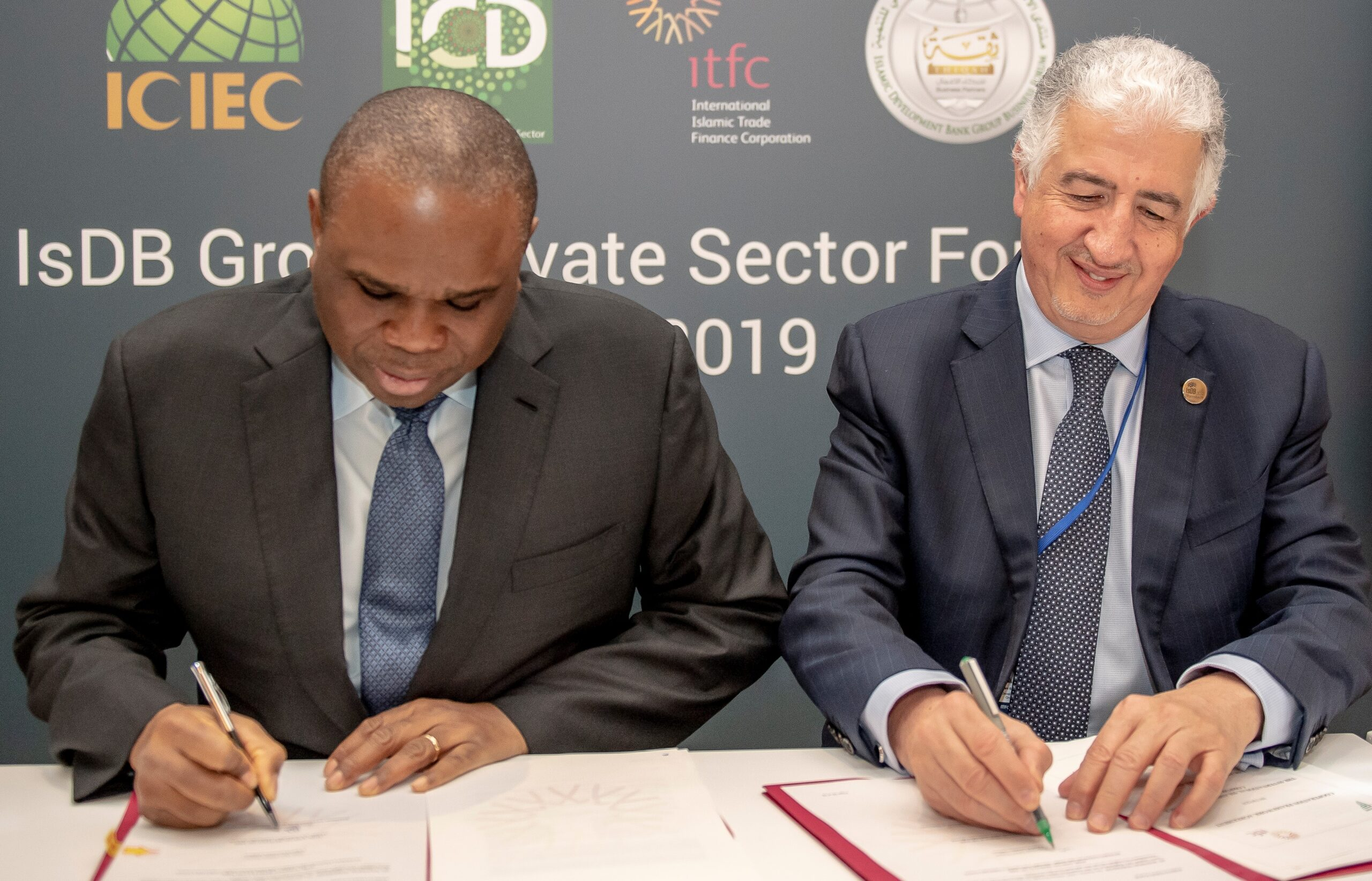 Hani Salem Sonbol, ITFC CEO and Benedict Okey Oramah president signing a finance agreement in 2019