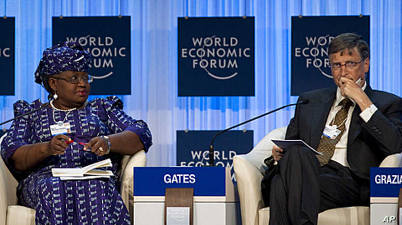 Dr. Ngozi Okonjo-Iweala, Chair of the Gavi Board with Bill Gates.File Picture from a panel discussion at the World Economic Forum in Davos 2012