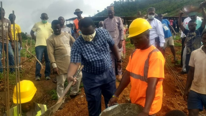 Father Augustine Berewa, Son of Late Solomon Ekuma Berewa together with former Minister of Basic and Senior Secondary School (MBSSE), Alpha Osman Timbo during the turning the sod for the construction of the Solomon Ekuma Berewa Academy at the Mongegba Community, Regent on Sunday.