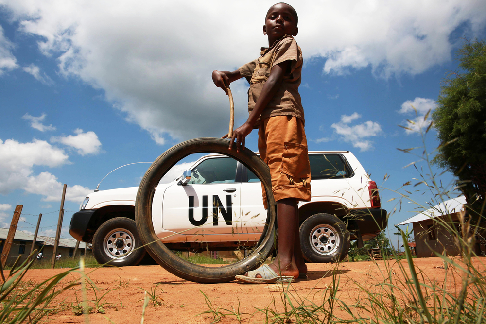 A child plays near a UN vehicle in 2014 in Beni in North Kivu province, where issues of fraud have been rife. Photo credit Abel Kavanagh, MONUSCO