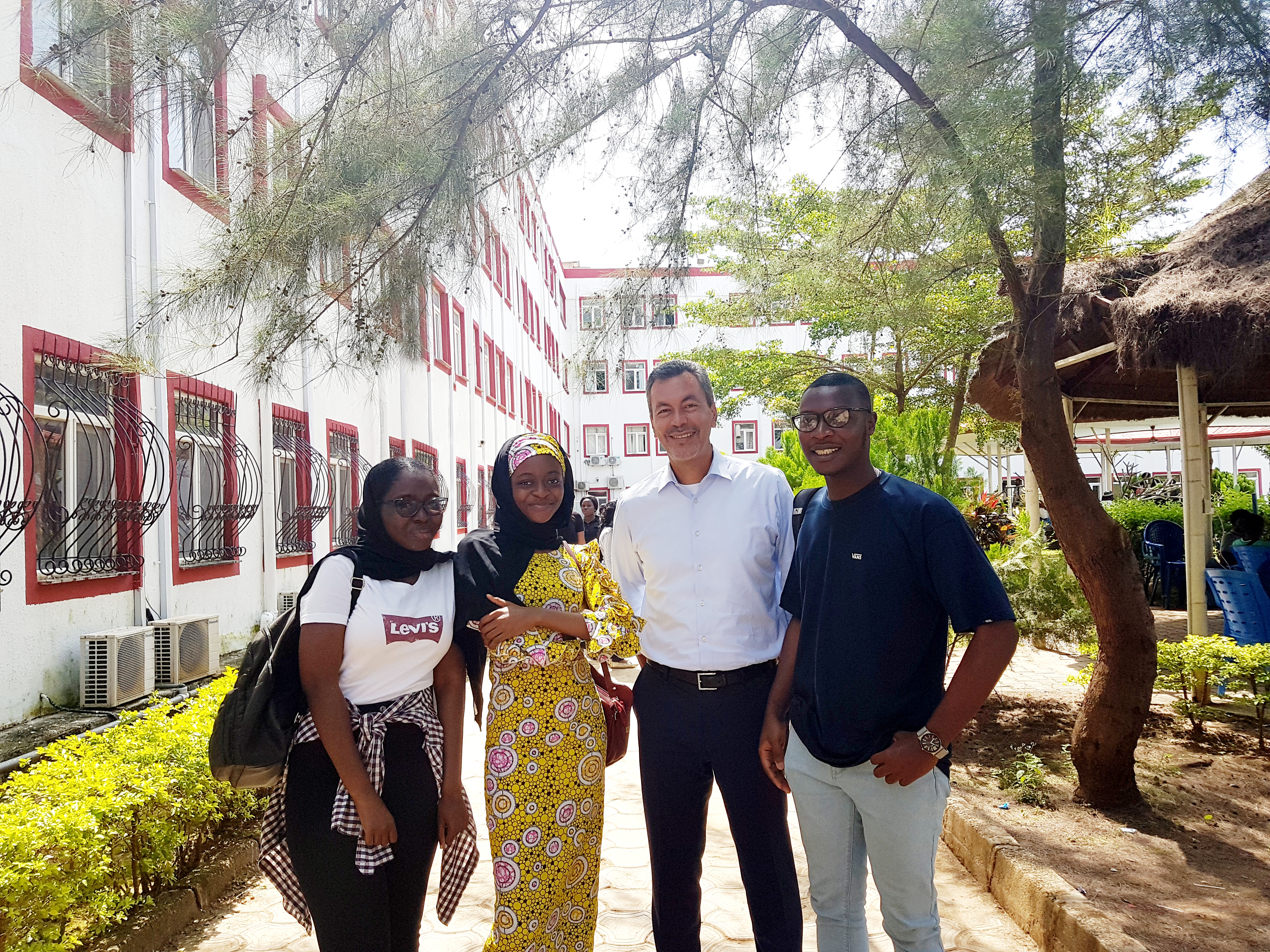 Luis Lopez CEO of Honoris with students at Nile University in Abuja copy