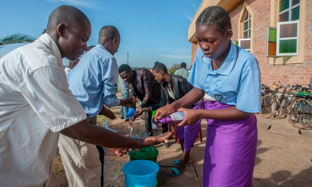People wash their hands as a preventive measure against the spread of coronavirus .Photo Amos Gumulira/AFP via Getty Images