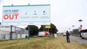 A coronavirus awareness billboard at a highway in Harare [Aaron Ufumeli/EPA]