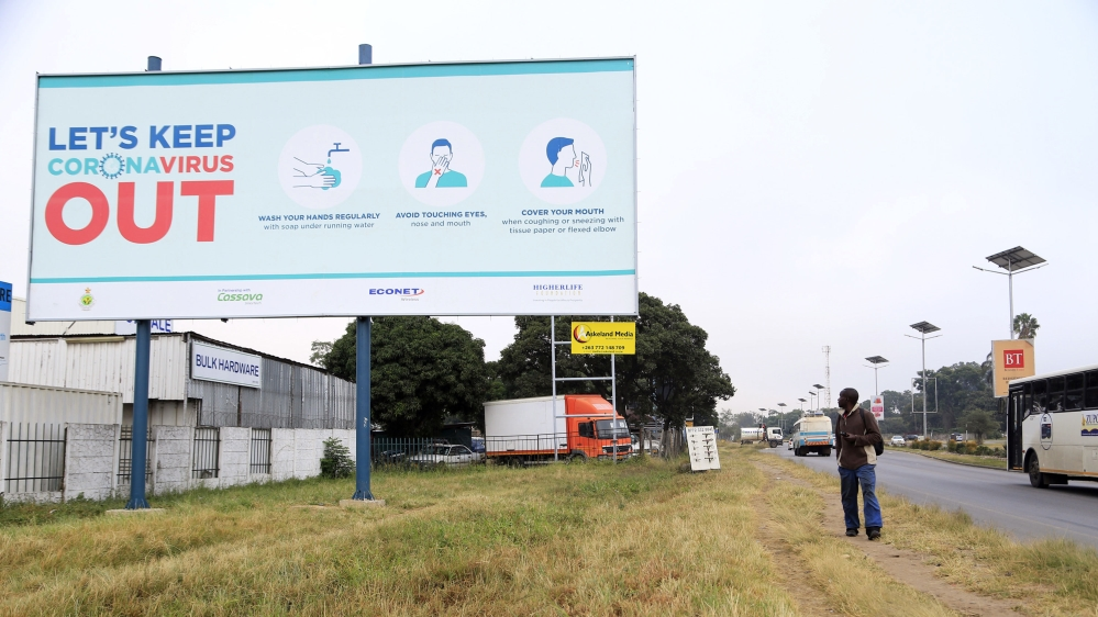A coronavirus awareness billboard at a highway in Harare [Aaron Ufumeli/EPA]