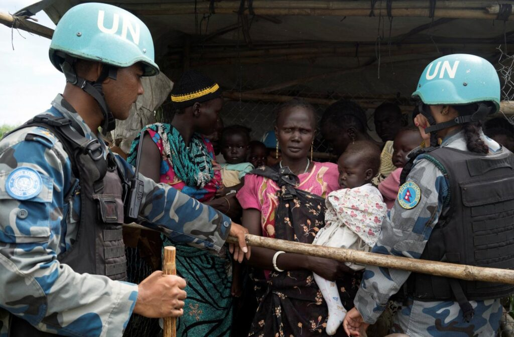 UN. peacekeepers engage with South Sudanese women and children before emergency supplies are distributed at a protection of civilians site in Juba .Photo credit Adriane Ohanesian/Reuters