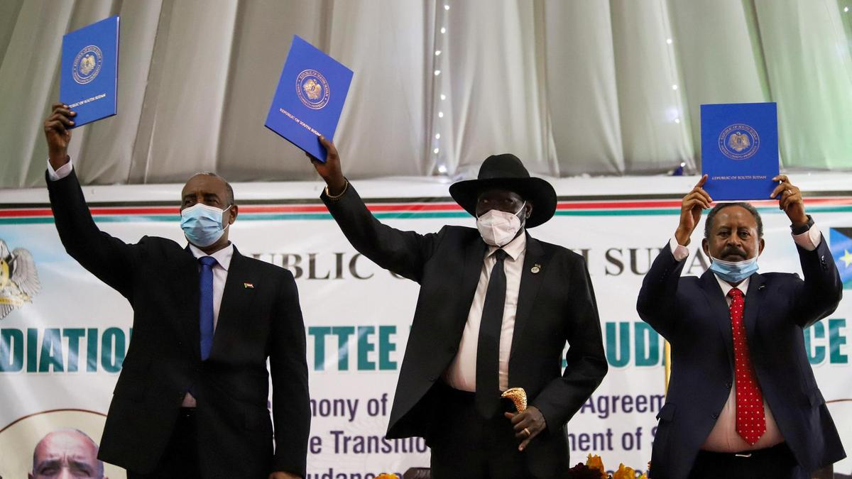 Sudan's Sovereign Council Chief General Abdel Fattah Al Burhan, South Sudan's President Salva Kiir, and Sudan's Prime Minister Abdalla Hamdok raise copies of a signed peace agreement with Sudan's five key rebel groups in Juba, South Sudan on August 31, 2020. Reuters