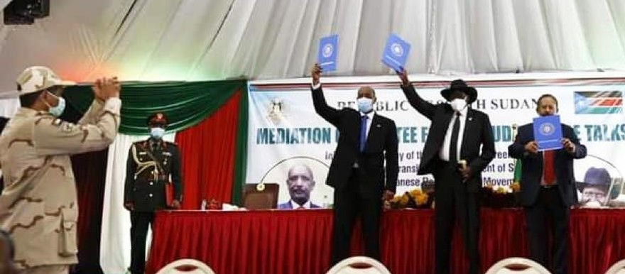 Lt Gen Mohamed Hamadan 'Hemeti', Deputy President of the Sovereign Council, and Commander-in-Chief of the paramilitary Rapid Support Forces (left) applauds as Chairman of Sudan's Sovereign Council Lt Gen Abdelfattah El Burhan, South Sudan President Salva Kiir, and Sudan's Prime Minister Abdallah Hamdok, display copies of the agreement .Photo credit RD correspondent