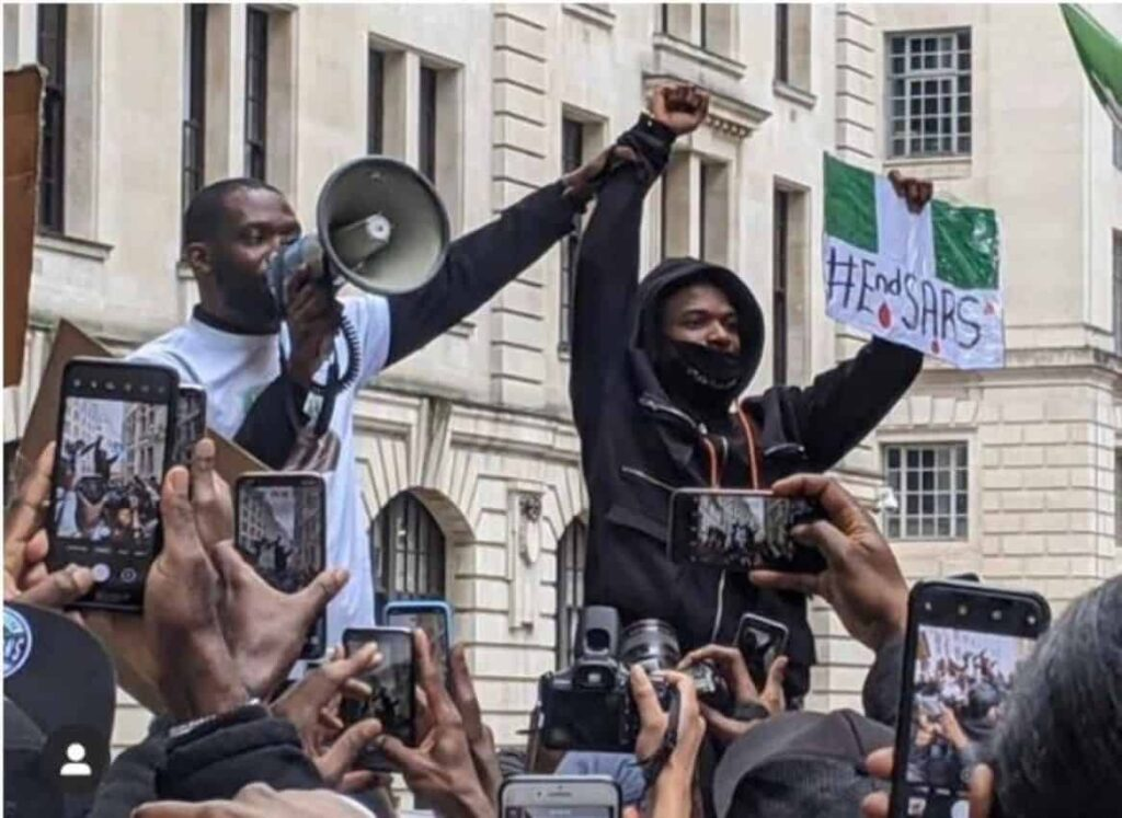 Nigerian music star Wizkid right, leads the End SARS protest in London. Star power was on full display during the protests in Nigeria and across the globe