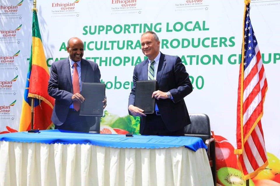 (L to R) Ethiopian Airlines Group CEO Tewolde GebreMariam and U.S. Ambassador Michael Raynor at the signature of a partnership between USAID and Ethiopian Airlines