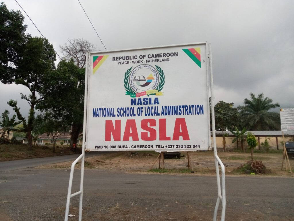 A sign post indicating the campus of the National School of Local Administration, NASLA in Buea