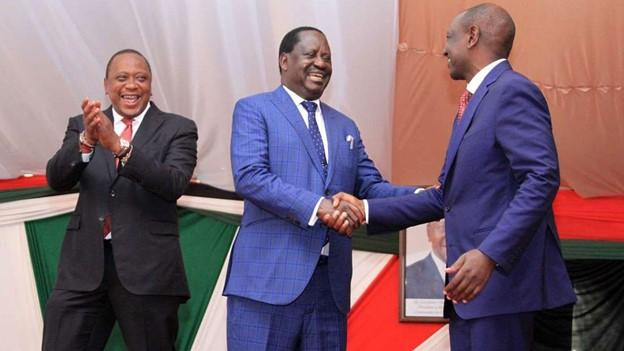 Ruto in a handshake with opposition leader Raila Odinga while President Kenyatta looks on.Both men are frontline candidates to succeed Kenyatta when his second and last mandate ends. Photo courtesy