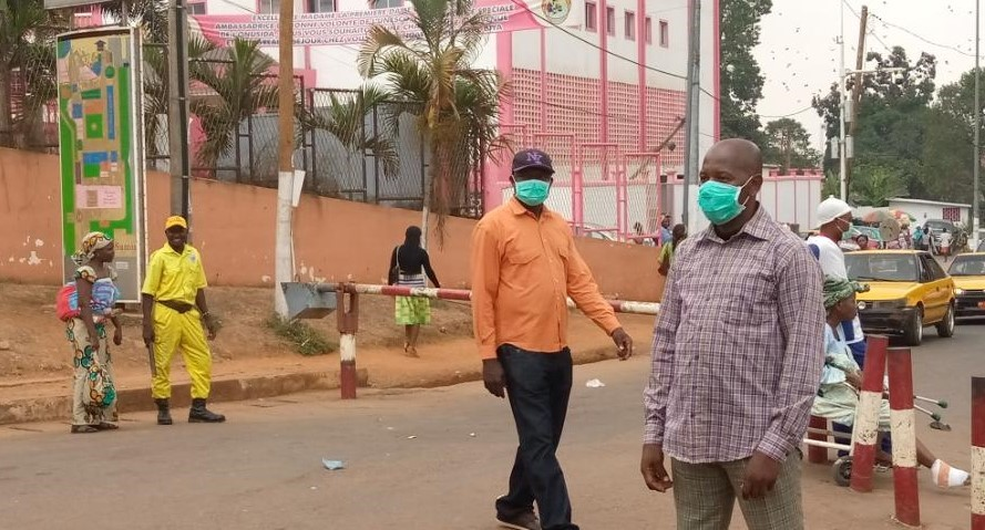 Cameroonians in Yaounde wear masks to protect themselves against the spread of the coronavirus