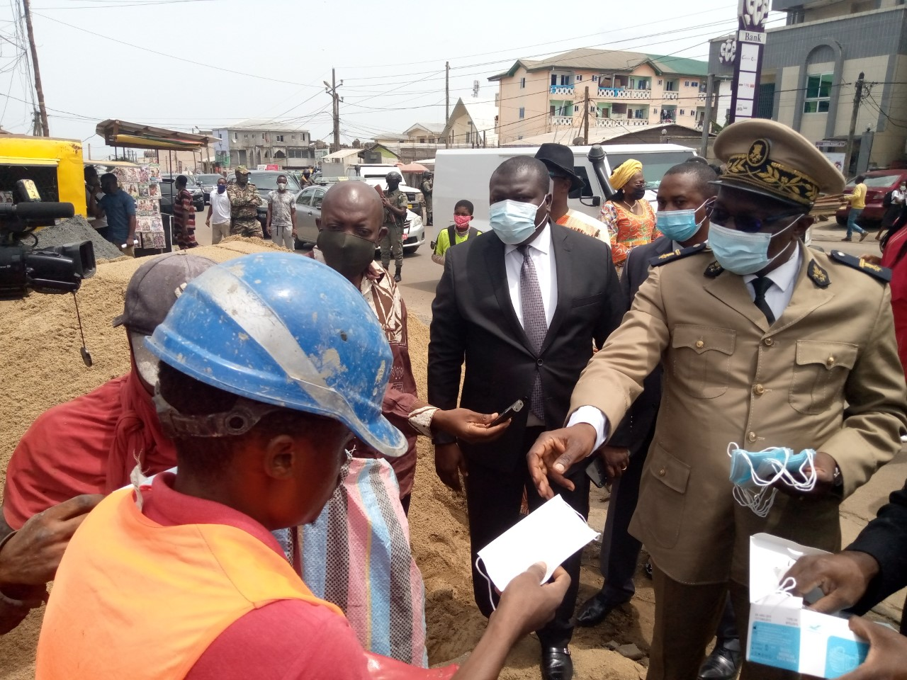 SW Governor Bernard Okalia Biilai hands a facemask in a bit to curb the coronavirus in the Region