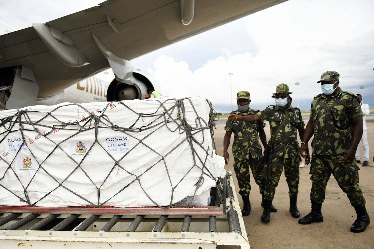 Malawian police guard AstraZeneca COVID-19 vaccines after the shipment arrived in Lilongwe, Malawi, Friday March 5, 2021. Canada is expecting its first shipments of AstraZeneca vaccine next week. (Associated Press/Thoko Chikondi)