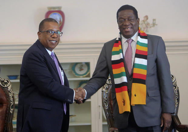 U.S. Ambassador to Zimbabwe Brian Nichols, left, shakes hands during a courtesy call with Zimbabwean President Emmerson Mnangagwa in Harare, in an August 15, 2018 file photo.TSVANGIRAYI MUKWAZHI/AP